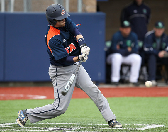 Peabody native and Salem State sophomore Genaro Ciulla (24) lines a single to right field as part of the Vikings' three-run 5th inning against Endicott on Wednesday afternoon. DAVID LE/Staff photo. 4/23/14