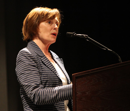 Dr. Patricia Maguire Meservey, President of Salem State University, speaks during Yom HaShoah 2014 held in the auditorium at Peabody Veterans Memorial High School on Monday evening. DAVID LE/Staff Photo. 4/28/14