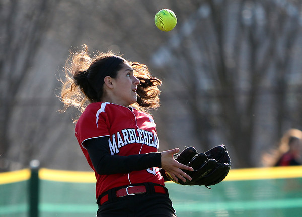Marblehead left fielder Allison Kapoll (6) keeps her eye on the ball after it popped out of her glove and records an out against Danvers. Danvers defeated Marblehead 6-1 on Wednesday afternoon behind Marblehead Veterans Middle School. DAVID LE/Staff photo 4/16/14