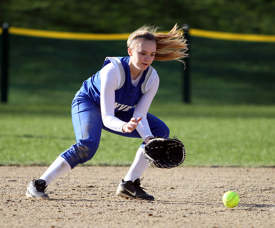 Danvers second baseman Hannah Llewellyn (11) fields a grounder and throws out a Marblehead batter during the second inning of play. Danvers defeated Marblehead 6-1 on Wednesday afternoon behind Marblehead Veterans Middle School. DAVID LE/Staff photo 4/16/14