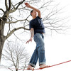 KEN YUSZKUS/Staff photo: Dan MacLean of Beverly, balances on a slackline strung between two trees at Dane Street Beach in Beverly.
