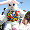 Eva Hammond, 4, of Beverly, smiles in surprise as the Easter Bunny appears out of nowhere to surprise her during Netcast's 4th annual Easter Egg Hunt held at Beverly High School on Saturday morning. DAVID LE/Staff photo. 4/19/14