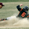KEN YUSZKUS/Staff photo. Beverly's Craig Hall slides safely into 2nd on a steal at the Lynn English at Beverly High School baseball game.