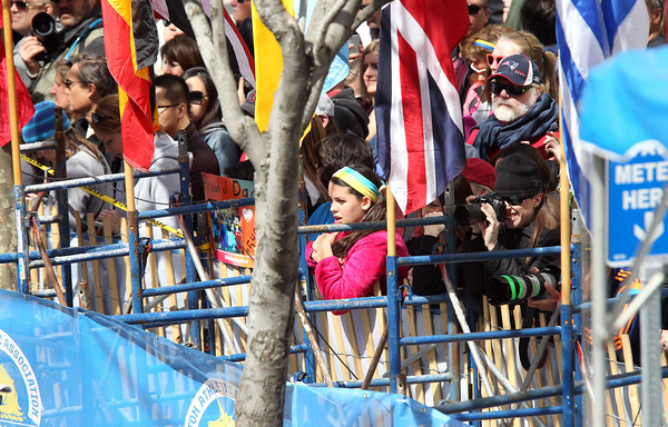 Thousands of people lined the streets next to the barricades near the finish line of the 118th Boston Marathon. DAVID LE/Staff photo 4/21/14