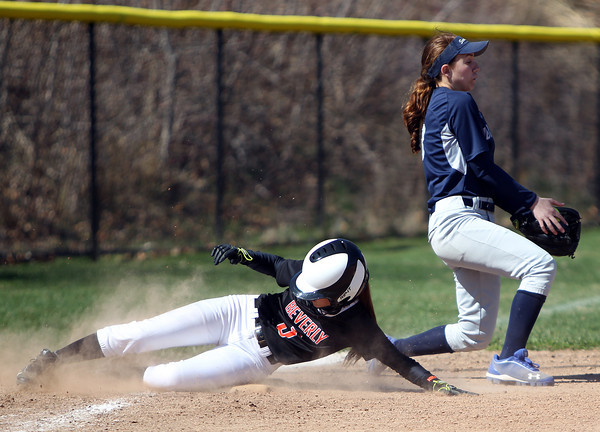 Beverly's Jackie Pia (5) slides safely into third base before Swampscott third baseman Sam Rizzo can handle the throw from the outfield. The Big Blue rallied from three-runs down in the bottom of the 7th inn in for a 10-9 walk off win over the Panthers in NEC action on Thursday afternoon. DAVID LE/Staff photo. 4/24/14