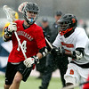 Marblehead midfielder Sam Paquette (14) shields the ball from Beverly sophomore midfielder Peter Mulumba (7) while in the Magicians offensive zone on Tuesday evening. DAVID LE/Staff photo 4/15/14