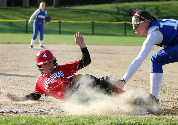 Marblehead's McKenzie Joyce (13), left, slides safely into third base to record a steal before Danvers third baseman Marisa Manson can apply the tag. Danvers defeated Marblehead 6-1 on Wednesday afternoon behind Marblehead Veterans Middle School. DAVID LE/Staff photo 4/16/14
