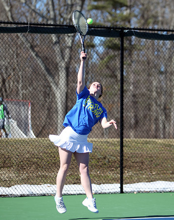 Pingree senior captain Erin Cunningham smashes a serve while playing No. 1 singles against Masco senior captain Danielle Dunn during their match on Tuesday afternoon. DAVID LE/Staff photo 4/1/14