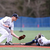 St. John's Prep senior captain Max Burt (6) waits to apply the tag to diving Peabody third baseman Bobby Tramondozzi (4) on a stolen base attempt on Saturday afternoon. DAVID LE/Staff photo 4/5/14