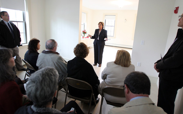 Cynthia Dunn, Executive Director of the Danvers Housing Authority opens the dedication of the 24 Cherry Street affordable housing unit on Wednesday morning. DAVID LE/Staff photo. 4/30/14