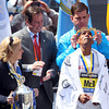 American Meb Keflezighi looks skyward as Boston Mayor Marty Walsh places a gold olive wreath upon his head after Keflezighi became the first American to win the Boston Marathon since 1983. DAVID LE/Staff photo 4/21/14