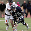 Hamilton-Wenham senior captain Matt Curran (13) tries to gain control of the ball again after it was knocked loose by Beverly senior midfielder Zach Duguid (16) on Friday afternoon. DAVID LE/Staff photo 4/4/14