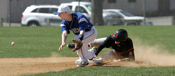 KEN YUSZKUS/Staff photo. Danvers' Andrew Olszak misses the throw as Beverly's Nicholas Cotraro is safe on 2nd during the Beverly at Danvers baseball game at Twi-Field.      4/25/14
