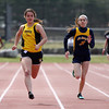 Bishop Fenwick senior Caitlin Parrott, left, outraces St. Mary's sophomore Diana Hallisey, right, to the finish line during the 200 on Tuesday morning at Bishop Fenwick High School in Peabody. DAVID LE/Staff photo. 4/22/14