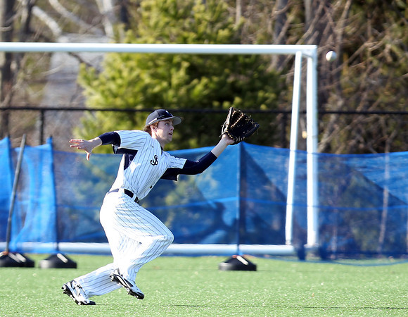 St. John's Prep senior center fielder Mark Etherington (11) tracks and hauls in a sharp liner off the bat of a Central Catholic player. The Eagles cruised to a 9-3 win over the Raiders at St. John's Prep in Danvers on Thursday afternoon. DAVID LE/Staff photo 4/10/14