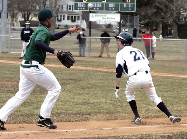 KEN YUSZKUS/Staff photo: Danvers' Ryan Kelleher gets run down between 3rd and home and is eventually tagged out during the Lynn Classical at Danvers baseball game  in home opener at Twi Field at Plains Park.