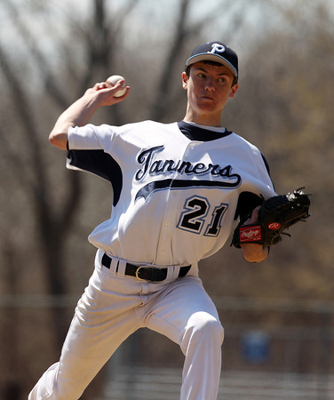 Peabody pitcher Matt Moorer delivers a pitch against Bishop Fenwick on Saturday afternoon. DAVID LE/Staff photo. 4/19/14