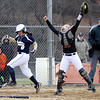 Beverly catcher Cori Coults (33), right, stretches high to snag a throw but Malden''s Taylor Figureredo (8) touches home plate to beat the force play and score another run.  DAVID LE/Staff photo. 4/17/14