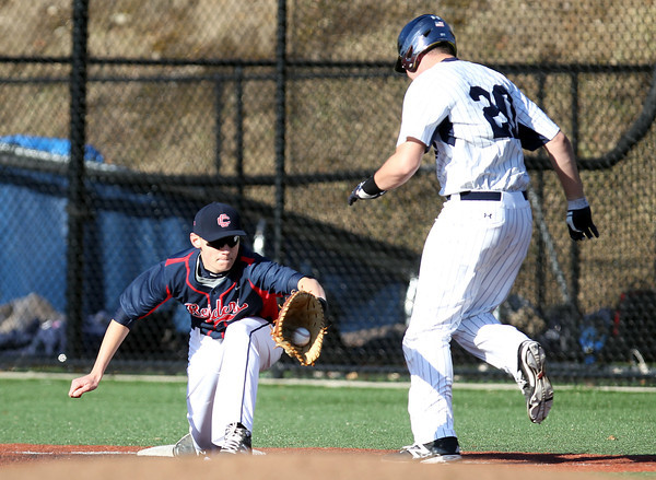 Central Catholic first baseman James Coen (12) makes the stretch to retire hustling St. John's Prep senior Rich Riley (20). The Raiders fell to the Eagles 9-3 at St. John's Prep in Danvers on Thursday afternoon. DAVID LE/Staff photo 4/10/14