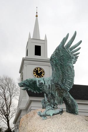 Ken Yuszkus/Staff photo: Hamilton: An eagle stands atop the war memorial near the First Congregational Church of Hamilton on Bay Road.