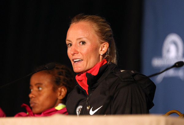 Marblehead native Shalane Flanagan talks with the media about her race strategy following her 7th place finish and PR of 2:322:02 in the 118th Boston Marathon. DAVID LE/Staff photo. 4/21/14