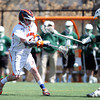 Salem State junior midfielder and Salem native Nate Staples (4) fires a shot on net against Plymouth State on Saturday afternoon. DAVID LE/Staff photo. 4/12/14