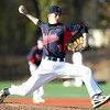 Central Catholic relief pitcher Connor Simpson (1) fires a pitch against St. John's Prep on Thursday. The Raiders fell to the Eagles 9-3 at St. John's Prep in Danvers on Thursday afternoon. DAVID LE/Staff photo 4/10/14