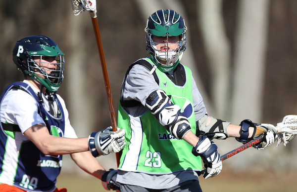 Pingree Boy's Lacrosse Senior Captain Defense Alex Salalayko (99) and Junior Attack Carter Rosano (23). DAVID LE/Staff photo 4/1/14