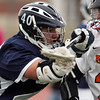 Hamilton-Wenham senior defenseman Alex Rodgers (40) stick checks Beverly senior attack Matt Page on Friday afternoon. DAVID LE/Staff photo 4/4/14