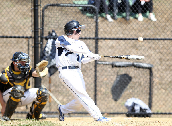 Peabody's CJ Alimonte ropes a two-RBI single to end the game in the bottom of the sixth inning of play on Saturday afternoon in a 18-3 Tanners rout of Bishop Fenwick. DAVID LE/Staff photo. 4/19/14