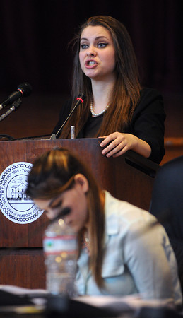 KEN YUSZKUS/Staff photo: Sarah Dunne plays Dr. Renatus Hartogs on the witness stand during the historical mock trial in Wiggin Auditorium at Peabody City Hall. Friday's case was the theory of a lone shooter in JFK's assassination and yesterday's case was the  JFK conspiracy.