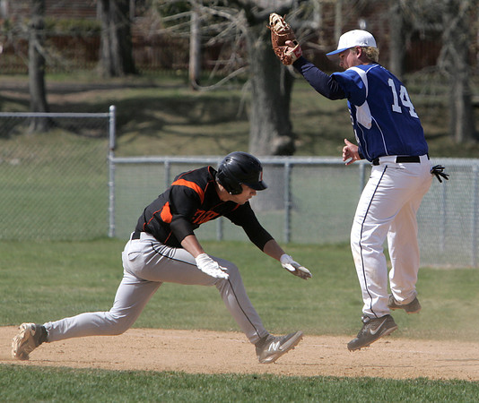 KEN YUSZKUS/Staff photo.  Beverly's Jon Berchoff is out trying to get back to 1st as  Danvers' Corey Crossley gets the throw from catcher Matt Andreas during the Beverly at Danvers baseball game at Twi-Field.      4/25/14