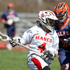Masco junior attack Cam Jung (4) tries to drive to the net while being defended by Walpole sophomore defense Alex Caskie (7) during the first half of play in the second game of the Creator's Cup held at Masconomet Regional High School in Topsfield on Thursday afternoon. DAVID LE/Staff photo. 4/24/14