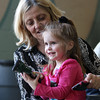 Three-year-old Alyvia Ramos smiles while her grandmother Susan Gagnon, of Salem, teaches her how to use a hose nozzle during the Earth Day Fest held at The Carlton School. The Carlton School hosted its 3rd Annual Earth Day Fest in the cafeteria on Thursday evening. In addition to crafts and games, Ward Two Councilor Heather Famico and Ward Six Councilor Beth Gerard served as two judges for a recycled art competition and Whole Foods Market and Mass Auduban set up table to share some information with the students. DAVID LE/Staff photo. 4/17/14