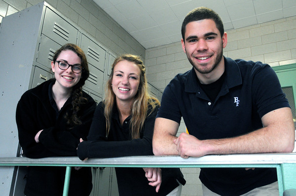 KEN YUSZKUS/Staff photo. From left, Samantha Keiran, Nina Groom, and Nicholas Tambini are students from  Bishop Fenwick High School.