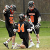 Beverly junior Nick Albano (8) and senior Nick Donovan (26) come over to celebrate sophomore Jordan Rawding's (34) third quarter goal against Danvers on Monday afternoon. DAVID LE/Staff Photo. 4/28/14