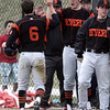 KEN YUSZKUS/Staff photo. Beverly's Craig Hall is congratulated by his teammates after making the first run of the game at the Lynn English at Beverly High School baseball game.