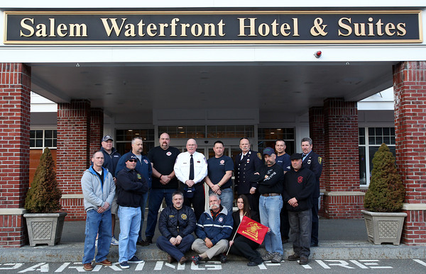 The Salem Waterfront Hotel has offered free rooms for any firefighters coming from around the country to Massachusetts for the funerals of Boston Firefighters Lt. Edward J. Walsh and Firefighter Michael R. Kennedy. Some of the firefighters staying at the hotel posed outside along with Katie Lombardi (front right), of the Salem Waterfront Hotel. DAVID LE/Staff photo 4/1/14