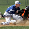 KEN YUSZKUS/Staff photo. Beverly's Tristan Fasheh is out at 2nd base as Danvers' Andrew Olszak makes the tag during the Beverly at Danvers baseball game at Twi-Field.      4/25/14
