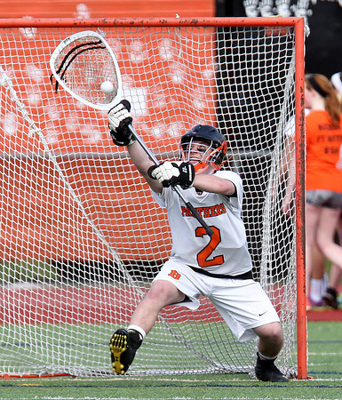 Beverly senior goalie Kevin Lally (2) makes a save against Gloucester on Thursday afternoon. DAVID LE/Staff photo. 5/1/14
