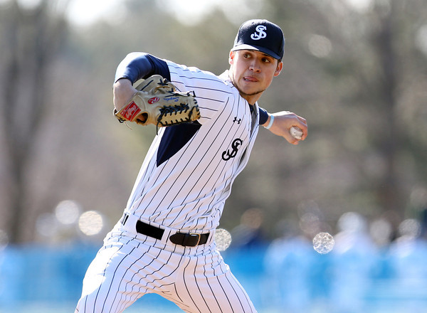 St. John's Prep senior starting pitcher Justin Snyder fires a strike against Central Catholic during the second inning of play. The Eagles cruised to a 9-3 win over the Raiders at St. John's Prep in Danvers on Thursday afternoon. DAVID LE/Staff photo 4/10/14
