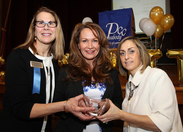 From left: Michelle Talisman, Chairwoman of the Peabody Area Chamber of Commerce, 2014 Mary Upton Ferrin Award recipient Heather Murray, of Citizens for Adequate Housing in Peabody, and Deanne Healey, President and CEO of the Peabody Area Chamber of Commerce.The 22nd annual Ferrin Community Service Awards were given out on Wednesday evening in the Wiggin Auditorium inside Peabody City Hall. DAVID LE/Staff photo 4/2/14
