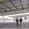 KEN YUSZKUS/Staff photo. Danversport Yacht Club general manager Paul DeLorenzo, left, and Matt Fitzgerald of Old Salt Works Partners walk under Danversport Yacht Club's new Solar parking canopy.