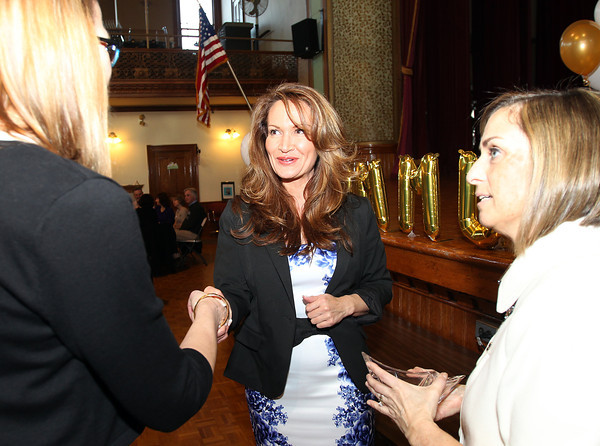 Heather Murray, center, 2014 recipient of the Mary Upton Ferrin Award from Citizens for Adequate Housing in Peabody, shakes hands with Michelle Talisman, left, Chairwoman of the Peabody Area Chamber of Commerce, as President and CEO of the Peabody Area Chamber of Commerce Deanne Healey, right, looks on. The 22nd annual Ferrin Community Service Awards were given out on Wednesday evening in the Wiggin Auditorium inside Peabody City Hall. DAVID LE/Staff photo 4/2/14