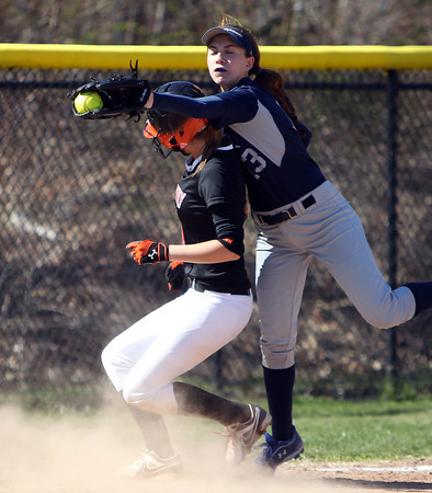 Swampscott third baseman Sam Rizzo (13) has to reach around Beverly's Caitlyn Munzing (11) to save an errant throw on a close play at third base. The Big Blue rallied from three-runs down in the bottom of the 7th inn in for a 10-9 walk off win over the Panthers in NEC action on Thursday afternoon. DAVID LE/Staff photo. 4/24/14