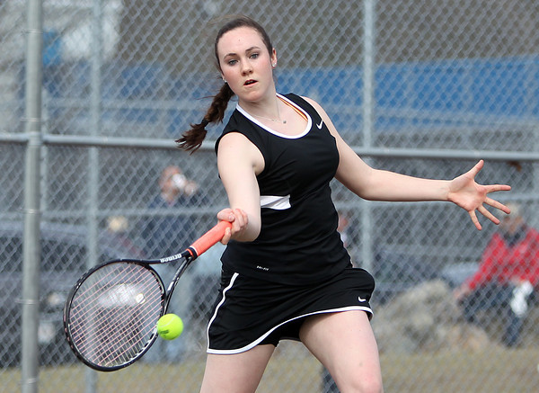 Marblehead junior first singles player Kelly Mealey returns a volley against Peabody on Friday afternoon. DAVID LE/Staff photo. 4/25/14