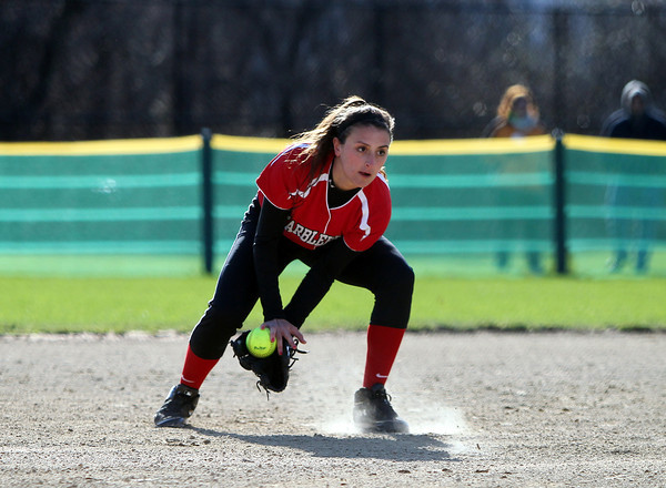 Marblehead shortstop Olivia Vener (23) fields a grounder cleanly and throws out a Danvers baserunner during the first inning of play. Danvers defeated Marblehead 6-1 on Wednesday afternoon behind Marblehead Veterans Middle School. DAVID LE/Staff photo 4/16/14
