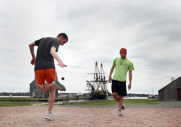 Kevin Hogan, 22, of Beverly, left, and his friend Nick Polini, visiting Hogan from Pennsylvania, play Hacky Sack in front of the Friendship in downtown Salem on Monday afternoon. DAVID LE/Staff photo. 4/28/14