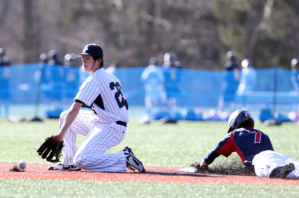 Central Catholic left fielder Kevin Regan (7) slides safely headfirst into second base on a successful steal attempt as St. John's Prep second baseman Rosario Missiti (26) fields the throw. The Raiders fell to the Eagles 9-3 at St. John's Prep in Danvers on Thursday afternoon. DAVID LE/Staff photo 4/10/14