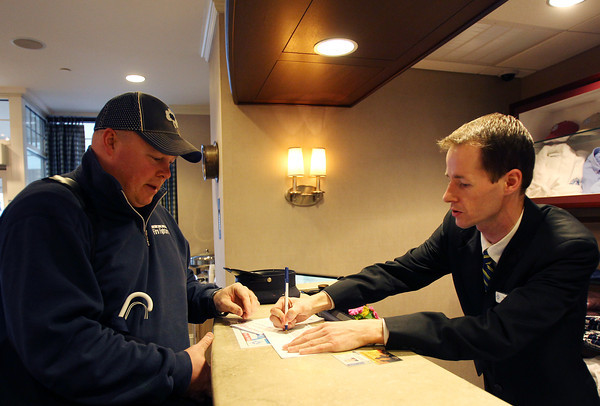 The Salem Waterfront Hotel has offered free rooms for any firefighters coming from around the country to Massachusetts for the funerals of Boston Firefighters Lt. Edward J. Walsh and Firefighter Michael R. Kennedy. Jack Gaffney, Vice President of the Scranton Firefighters IAFF Local #60, left, gets checked into the hotel by Salem Waterfront Front Desk Supervisor Ryan Miller on Tuesday evening. DAVID LE/Staff photo 4/1/14